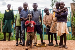 What else do you need when you have a wheel and a stick? Well, these beautiful children know very well what they wish for. (Kenya, 2017)